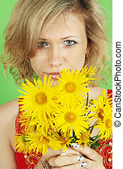 woman with a bouquet - A beautiful woman with a bouquet of...