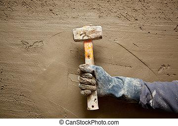 hammer man with gloves in grunge cement background - hammer...