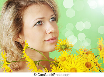 woman with a flowers - A beautiful woman with a bouquet of...