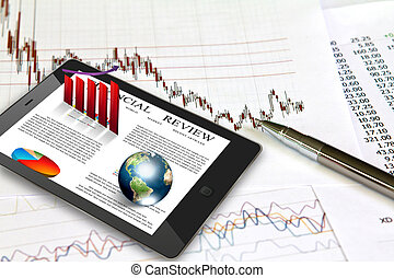 Touch pad and financial Graphs (Elements of this image furnished by NASA)