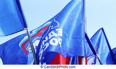 Flags of United Russia political party during the May Day demonstration