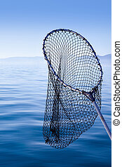 fishing landing net in blue sea