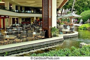 Open air outdoor cafe 2 - An opened air cafe in a tropical...