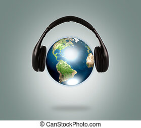 Earth with headphone Elements of this image furnished by...