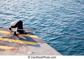 Bollard in port with rope looped around