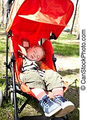 Kid sleeps the buggy