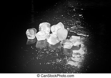 black and white ice cubes on iced water - black and white...