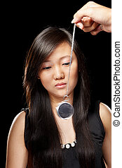Hypnotize - Young Chinese lady being hypnotized with...