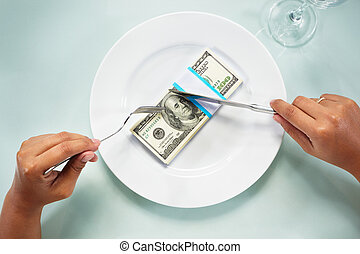 Eating the dollar bills - People hand eating the dollar...