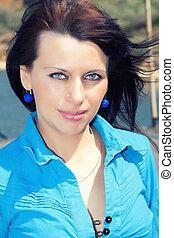 portrait of brunette women with blue eyes