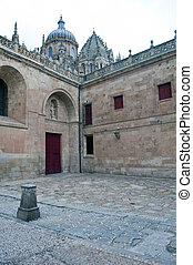 Back yard of the Cathedral of Salamanca with a red door at...