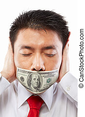 Bribe concept, mouth sealed with dollar bill - Chinese young...