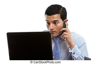 Man at computer making or receiving phone call - A man...