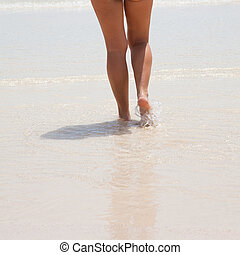 female legs in shallow water