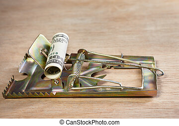 Mousetrap with money bait - Mousetrap placed on with money...