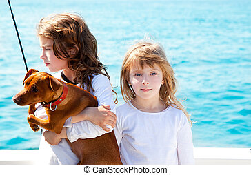 sister kid girls with dog on the sea - sister kid girls with...