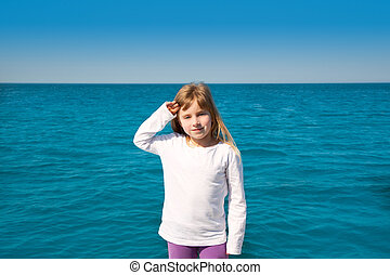 blond little kid girl sailing in a boat