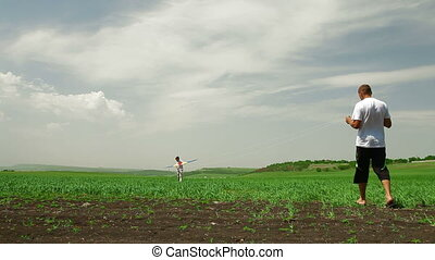 Playing With Kite In Field