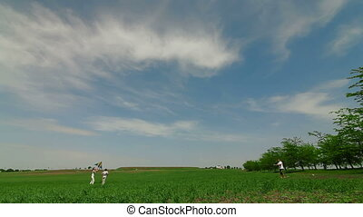 Family Playing With Kite In Field