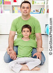 Father and son together at home