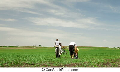 Family Riding On A Bicycles