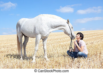 Young woman and Horse - Smiling Young Woman Posing With Her...