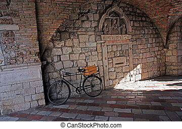Old City Kotor - A bicycle against the wall in the passage...