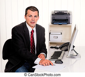 businessman in office with a computer - young businessman in...