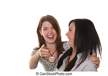 two young women burst into laughter - two young girls see...