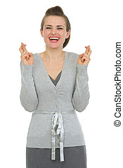 Happy woman employee with crossed fingers