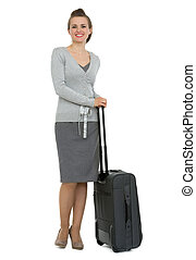 Full length portrait of traveling woman with suitcase