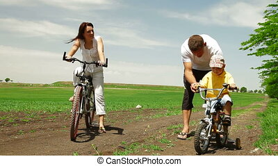 Family Cycling Together