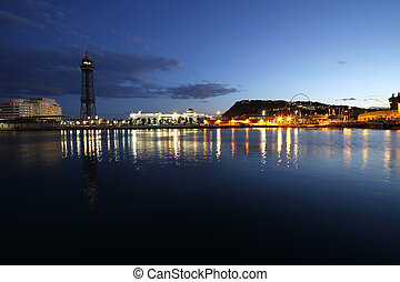 Barcelona, Spain skyline at night. Horbor view