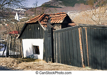 Gate - Primitive Transylvanian house facade with old gate...