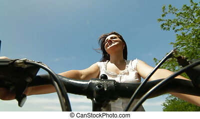 Woman Riding The Bike
