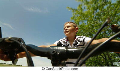 Child Riding The Bike