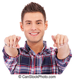 young casual man pointing