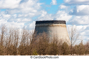 Cooling tower half ready in chernobyl with sky