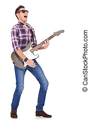 screaming guitarist playing - guitarist playing his electric...