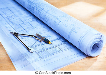 Blueprint on wooden desk - Blueprint of house design on...