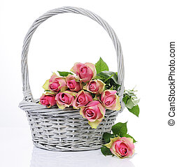 bouquet of pink roses in basket isolated on white background...