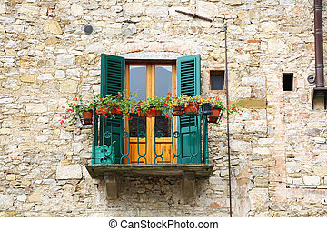 Balcony Toscany - a balcony of an old stone house in...