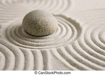 Zen stone - Stone on sand background Zen concept
