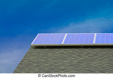 Solar PV panels on roof with Blue Sky