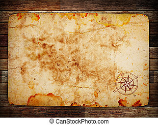 old treasure map on wooden background wih compass