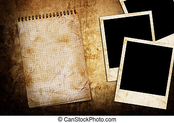 old used notebook on grunge background with photo frame