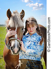 Girl and horse - Portrait of the girl embracing a horse