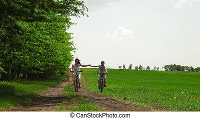 Family Cycling In The Summer Time - Mother and child riding...