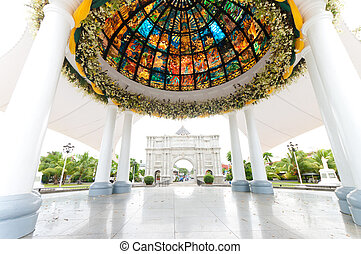 pavilion with stained glass in front of the Naga...
