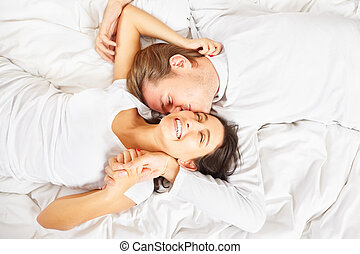 Romantic couple - A happy romantic couple pose on whte...